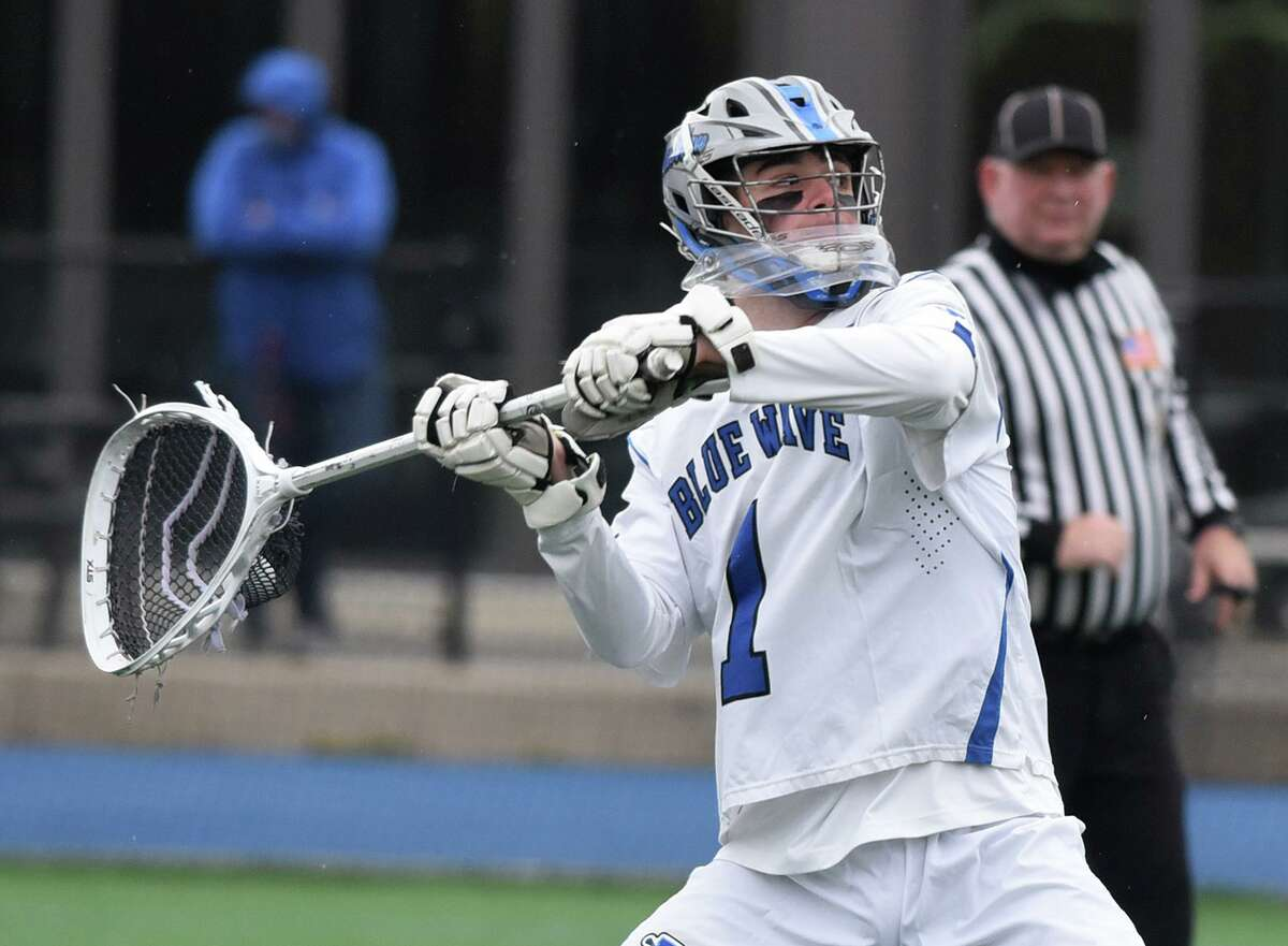 Darien goalie Andy Demopoulos passes the ball down the field against Glastonbury during a boys lacrosse game at Darien High School on Friday, April 16, 2021.