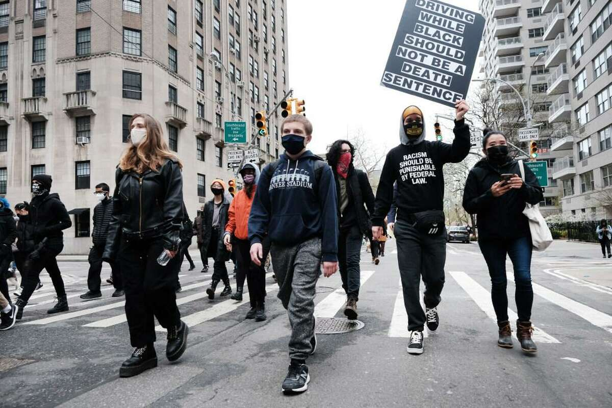 Demonstrators march in Manhattan to protest the police killing of Daunte Wright, a Black man, in Minnesota.