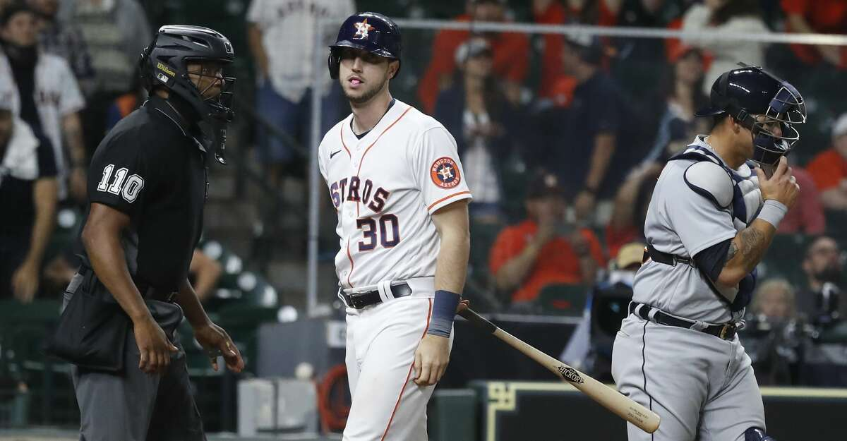 Houston Astros right fielder Kyle Tucker (30) reacts after striking out with the bases loaded to end the ninth inning of an MLB baseball game at Minute Maid Park, in Houston, Wednesday, April 14, 2021.