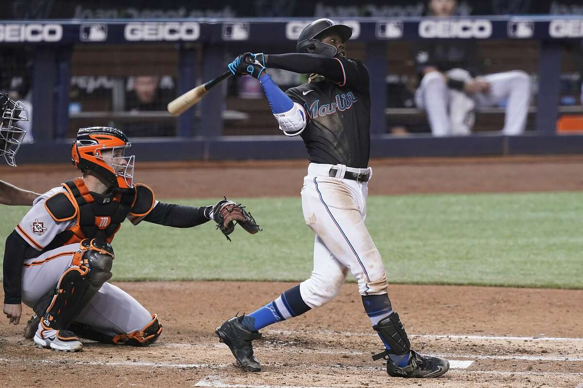 Miami Marlins' Jazz Chisholm Jr. hits a home run during the fifth inning of a baseball game against the San Francisco Giants, Friday, April 16, 2021, in Miami. (AP Photo/Marta Lavandier)