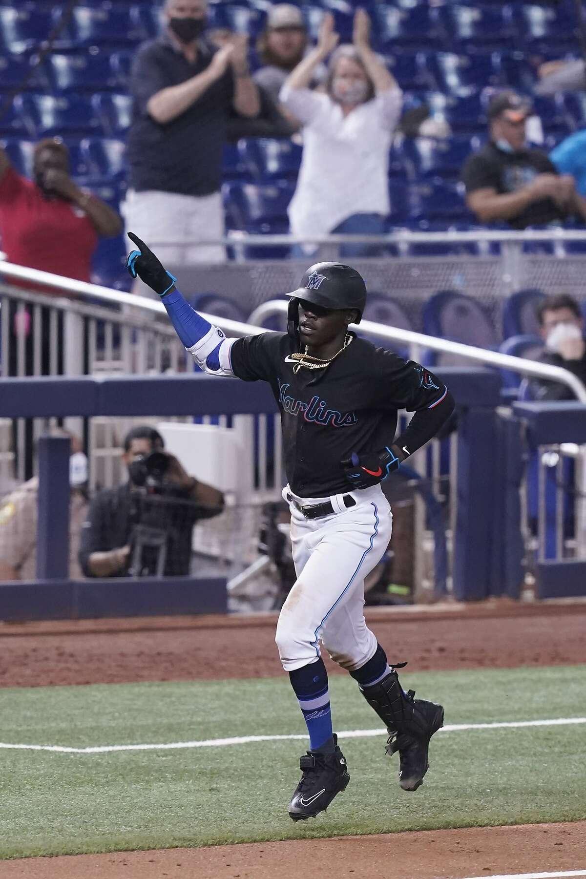 Miami Marlins' Jazz Chisholm Jr. gestures after hitting a home run during the fifth inning of a baseball game against the San Francisco Giants, Friday, April 16, 2021, in Miami. (AP Photo/Marta Lavandier)