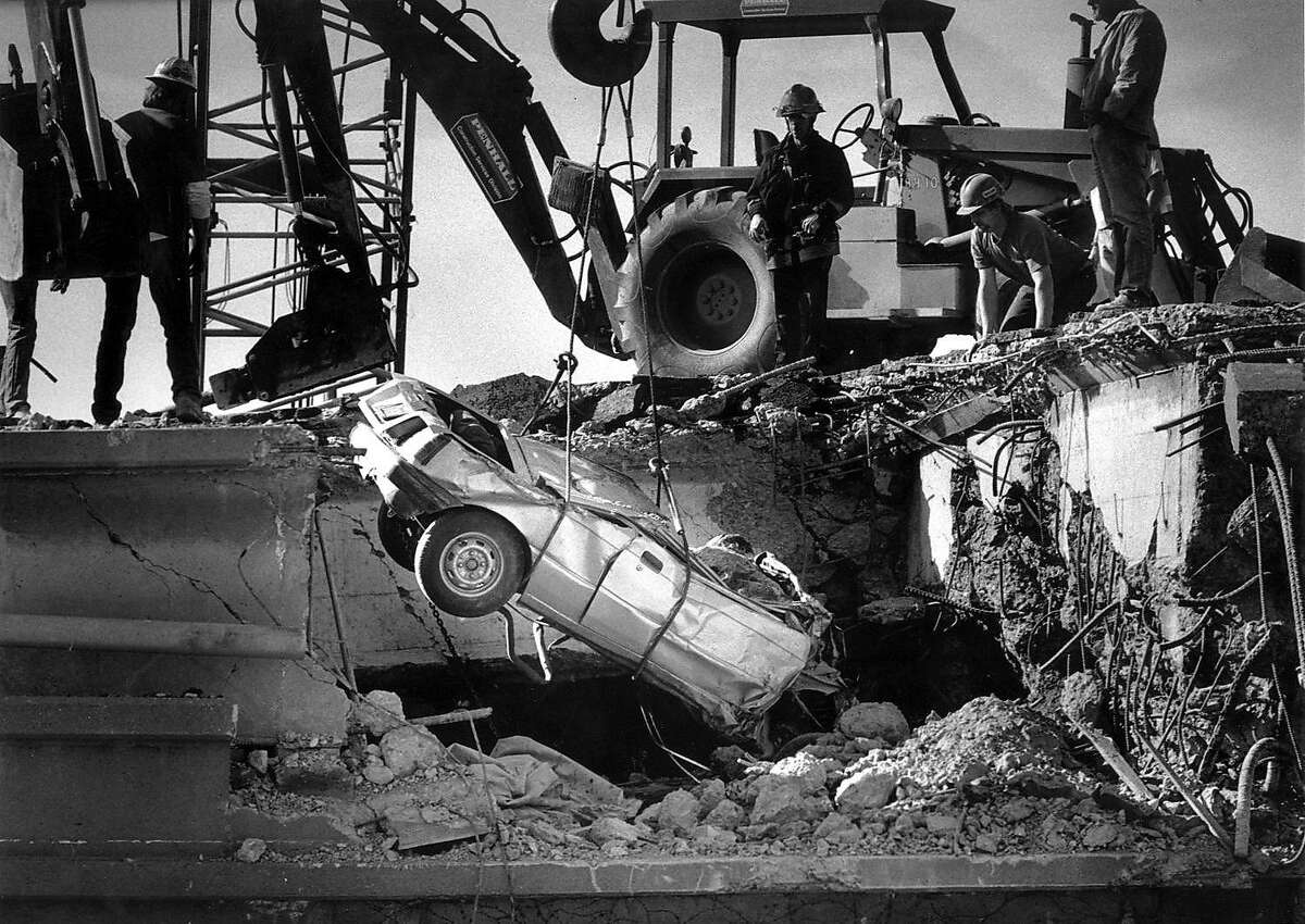 A car was damaged when the Cypress Freeway collapsed on top of the lower deck in Oakland during the 1989 Loma Prieta earthquake.
