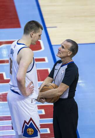 Denver Nuggets center Nikola Jokic (15) talks with referee Ken Mauer (41) during a timeout in the third quarter of an NBA game between the Houston Rockets and Denver Nuggets on Friday, April 16, 2021, at Toyota Center in Houston. Photo: Mark Mulligan/Staff Photographer / © 2021 Mark Mulligan / Houston Chronicle