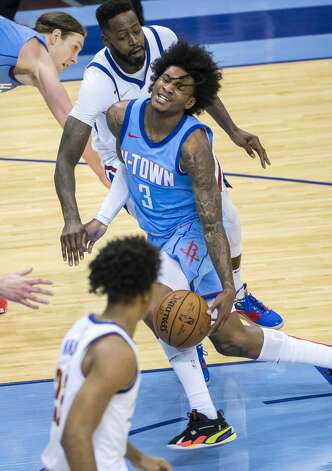 Houston Rockets guard Kevin Porter Jr. (3) is fouled on a drive during the third quarter of an NBA game between the Houston Rockets and Denver Nuggets on Friday, April 16, 2021, at Toyota Center in Houston. Photo: Mark Mulligan/Staff Photographer / © 2021 Mark Mulligan / Houston Chronicle