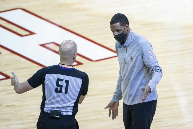 Rockets head coach Stephen Silas talks with referee Aaron Smith (51) during the third quarter of an NBA game between the Houston Rockets and Denver Nuggets on Friday, April 16, 2021, at Toyota Center in Houston. Photo: Mark Mulligan/Staff Photographer / © 2021 Mark Mulligan / Houston Chronicle