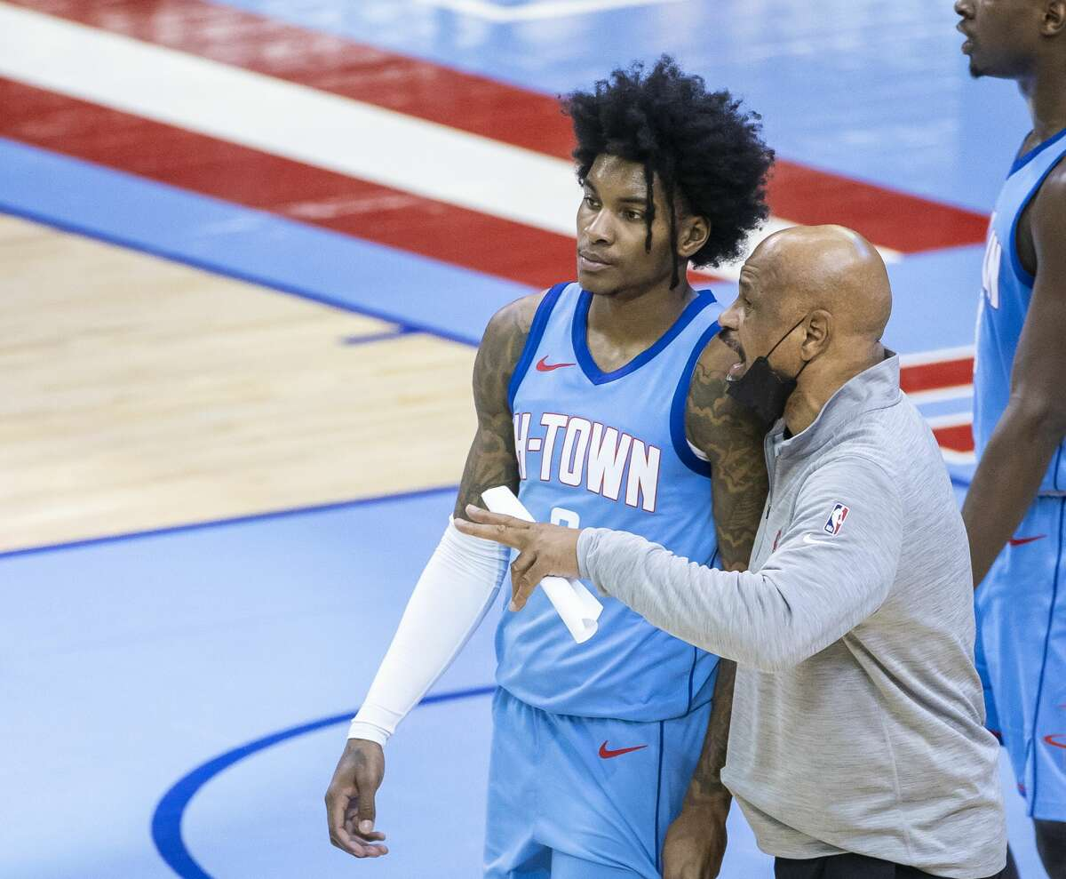 Rockets assistant coach John Lucas talks to Houston Rockets guard Kevin Porter Jr. (3) during the third quarter of an NBA game between the Houston Rockets and Denver Nuggets on Friday, April 16, 2021, at Toyota Center in Houston.