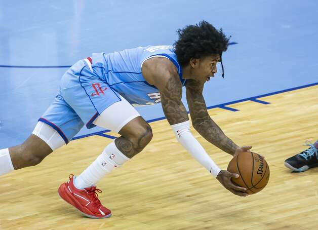Houston Rockets guard Kevin Porter Jr. (3) grabs a loose ball during the second quarter of an NBA game between the Houston Rockets and Denver Nuggets on Friday, April 16, 2021, at Toyota Center in Houston. Photo: Mark Mulligan/Staff Photographer / © 2021 Mark Mulligan / Houston Chronicle
