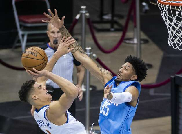Denver Nuggets forward Michael Porter Jr. (1) tries to shoot over Houston Rockets center Christian Wood (35) during the third quarter of an NBA game between the Houston Rockets and Denver Nuggets on Friday, April 16, 2021, at Toyota Center in Houston. Photo: Mark Mulligan/Staff Photographer / © 2021 Mark Mulligan / Houston Chronicle