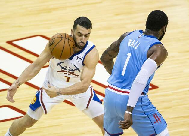 Houston Rockets guard John Wall (1) loses the ball to Denver Nuggets guard Facundo Campazzo (7) during the first quarter of an NBA game between the Houston Rockets and Denver Nuggets on Friday, April 16, 2021, at Toyota Center in Houston. Photo: Mark Mulligan/Staff Photographer / © 2021 Mark Mulligan / Houston Chronicle