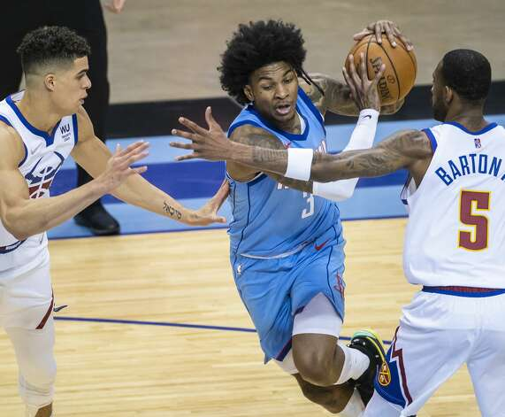 Houston Rockets guard Kevin Porter Jr. (3) drives during the third quarter of an NBA game between the Houston Rockets and Denver Nuggets on Friday, April 16, 2021, at Toyota Center in Houston. Photo: Mark Mulligan/Staff Photographer / © 2021 Mark Mulligan / Houston Chronicle