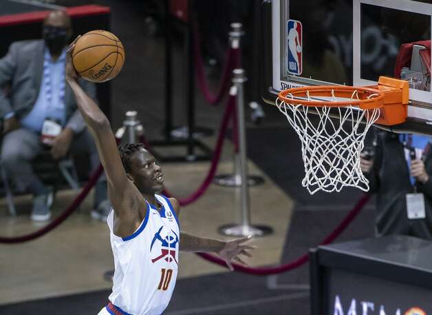 Denver Nuggets center Bol Bol (10) dunks during the fourth quarter of an NBA game between the Houston Rockets and Denver Nuggets on Friday, April 16, 2021, at Toyota Center in Houston. Photo: Mark Mulligan/Staff Photographer / © 2021 Mark Mulligan / Houston Chronicle