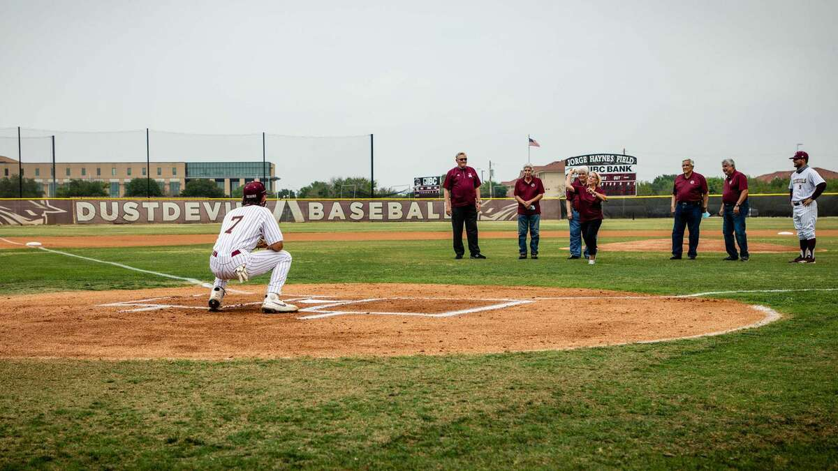 Cynthia Haynes Ramirez threw out the first pitch Friday as TAMIU honored the Haynes family before the game.