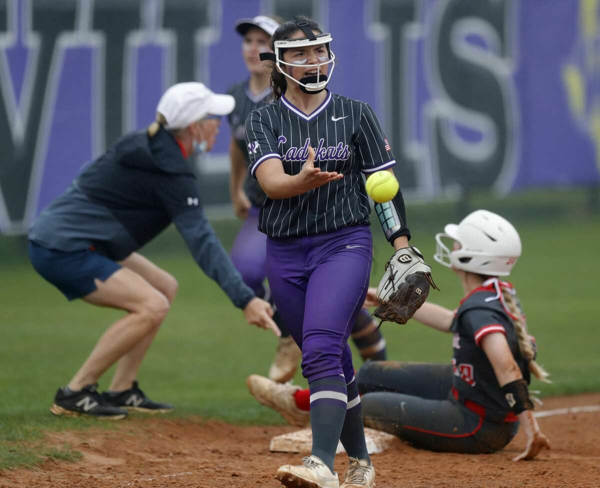 Willis third baseman Hannah Hartman (7) reacts after tagging out Abby Henderson #20 of Oak Ridge to end the top of the fifth inning of a District 13-6A high school softball game at Willis High School, Friday, April 16, 2021, in Willis.