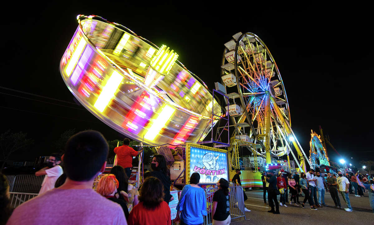 Laredoans head to the Sames Auto Arena parking lot, Friday, April 16, 2021, for the Spring Fling Carnival.