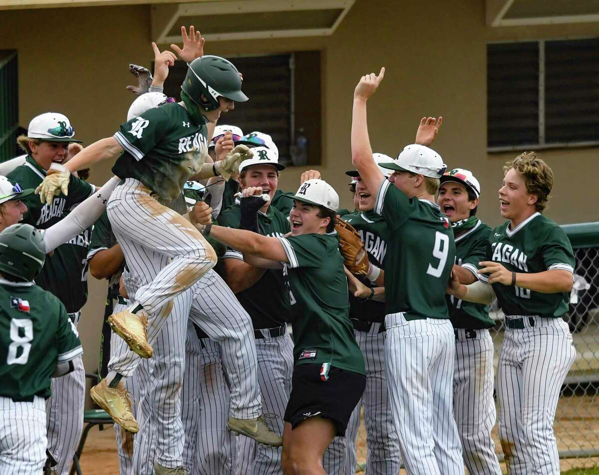 Ashton Beaird of Reagan jumps in celebration after scoring against Brandeis during high-school baseball action at the Blossom Athletic Center on Friday, April16, 2021. Reagan won, 9-2.