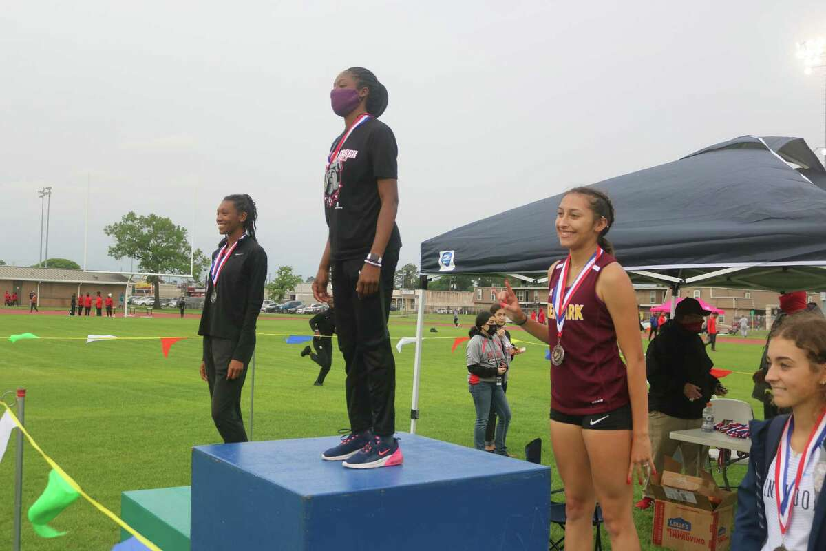 Deer Park's Kameron Huerta finds herself on the medal stand for the long jump after nabbing third place. The Lady Deer, who finished fourth in the team standings, scored most of their points in the field events.
