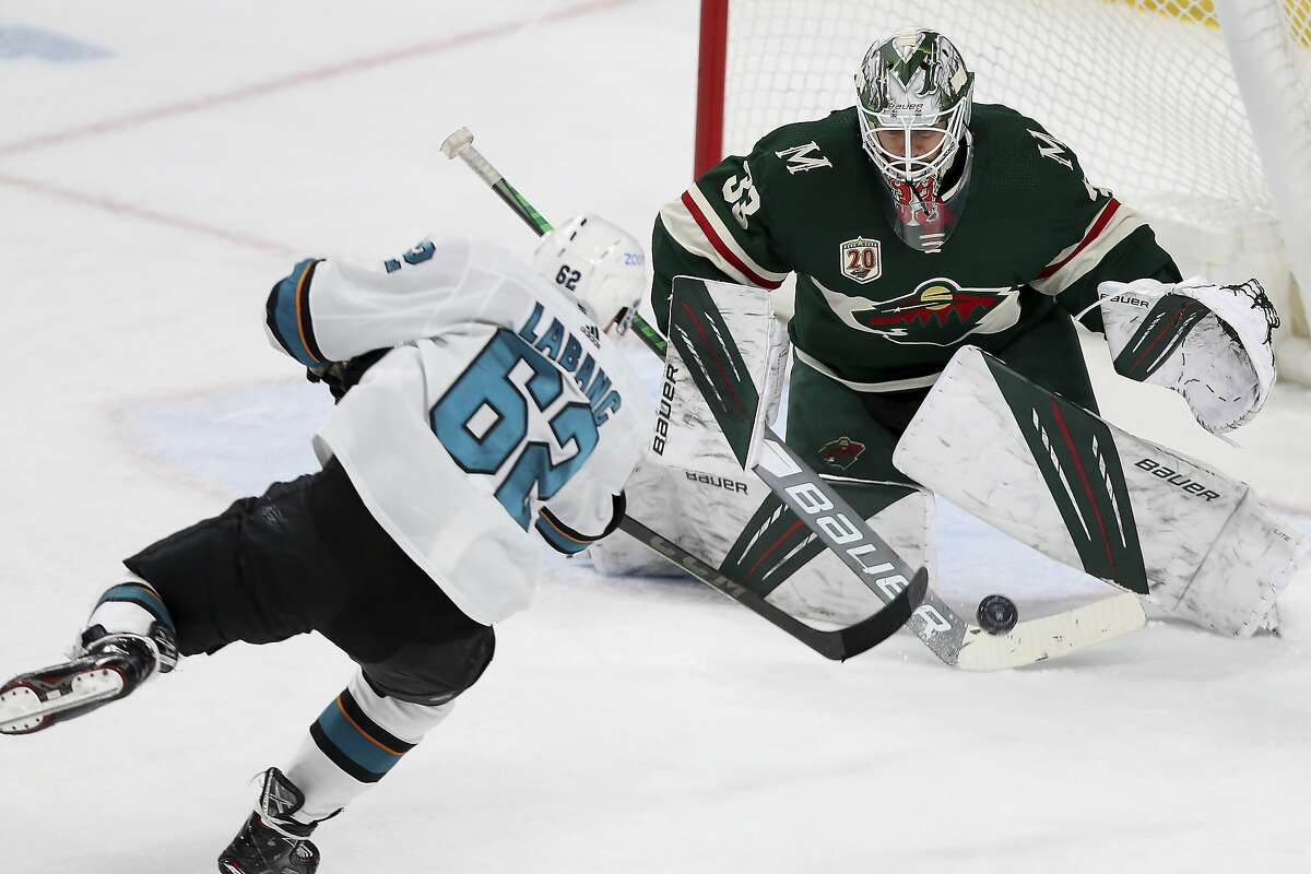Minnesota goalie Cam Talbot turns aside a third-period shot by the Sharks' Kevin Labanc. Talbot had 20 saves as the Wild dealt San Jose its fourth consecutive loss.