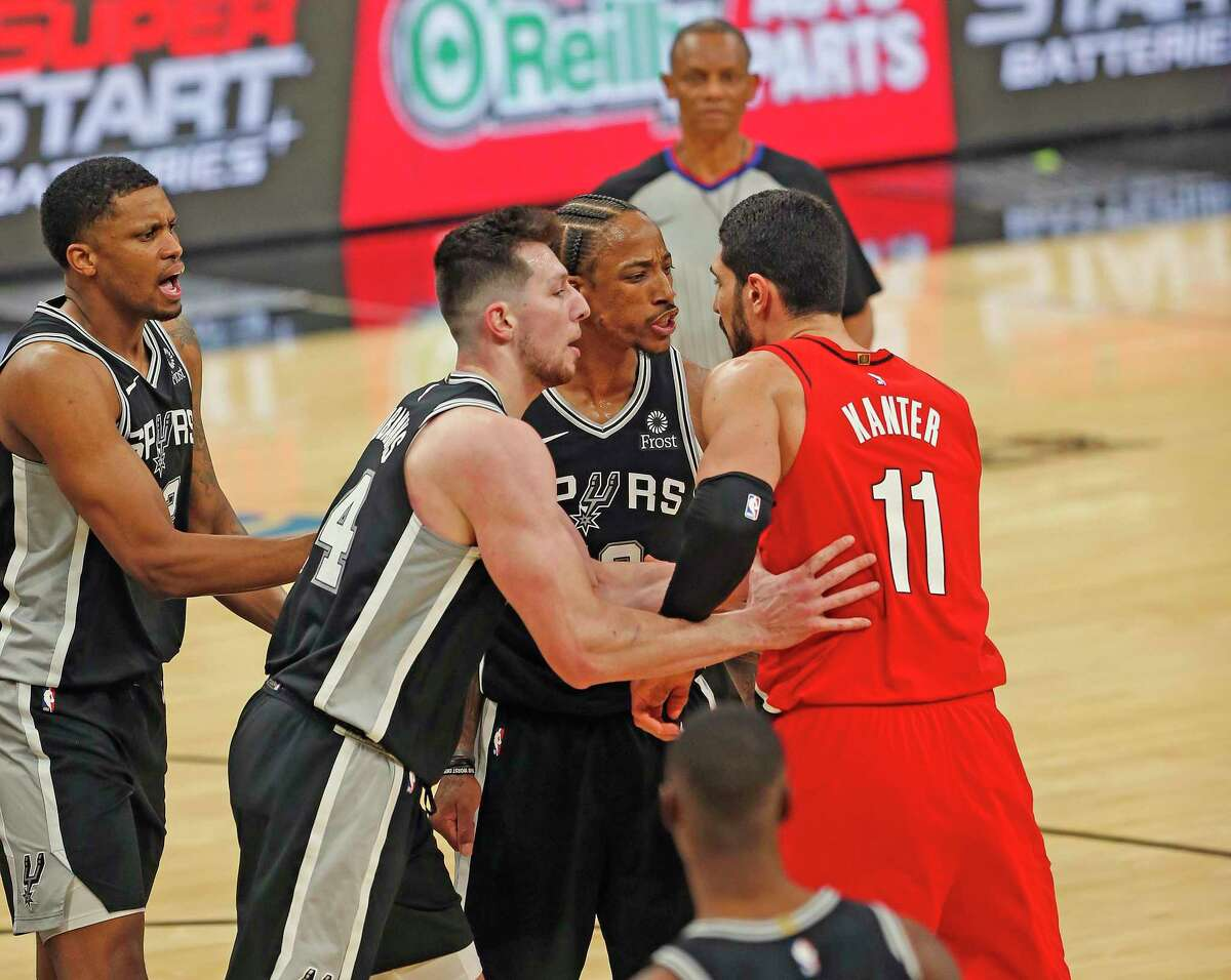 SAN ANTONIO, TX - APRIl 16: DeMar DeRozan #10 of the San Antonio Spurs and Enes Kanter #11 of the Portland Trailblazers had to be separated by Drew Eubanks #14 of the San Antonio Spurs after a hard fall by DeRozan in the second half at AT&T Center on April 16, 2021 in San Antonio, Texas. NOTE TO USER: User expressly acknowledges and agrees that , by downloading and or using this photograph, User is consenting to the terms and conditions of the Getty Images License Agreement. (Photo by Ronald Cortes/Getty Images)