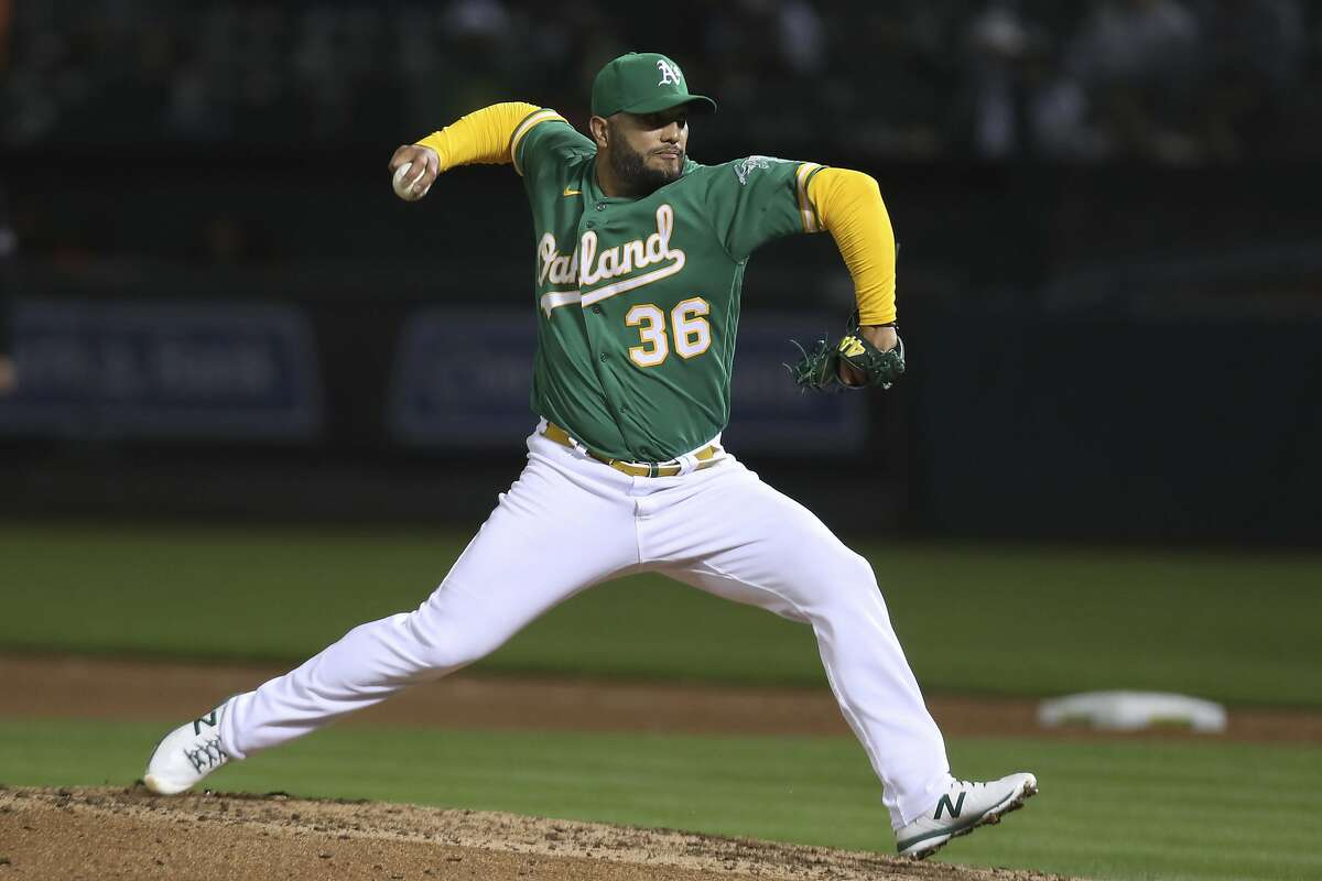 Oakland Athletics pitcher Yusmeiro Petit throws to a Detroit Tigers batter during the seventh inning of a baseball game in Oakland, Calif., Friday, April 16, 2021. (AP Photo/Jed Jacobsohn)