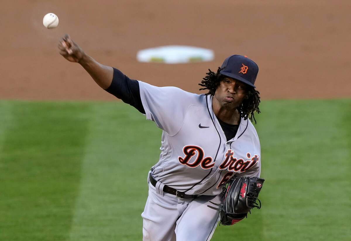 OAKLAND, CALIFORNIA - APRIL 16: Jose Urena #62 of the Detroit Tigers pitches against the Oakland Athletics in the first inning at RingCentral Coliseum on April 16, 2021 in Oakland, California. (Photo by Thearon W. Henderson/Getty Images)