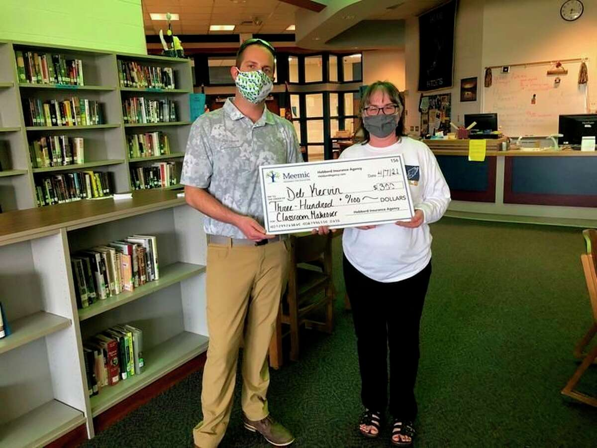 Teacher Deb Kervin of Bad Axe High School has been awarded a $300 Classroom Grant for being a teacher who has gone above and beyond throughout her career. This grant was gifted from the Hebberd Agency of Bad Axe and the Meemic Foundation. (Submitted Photo)