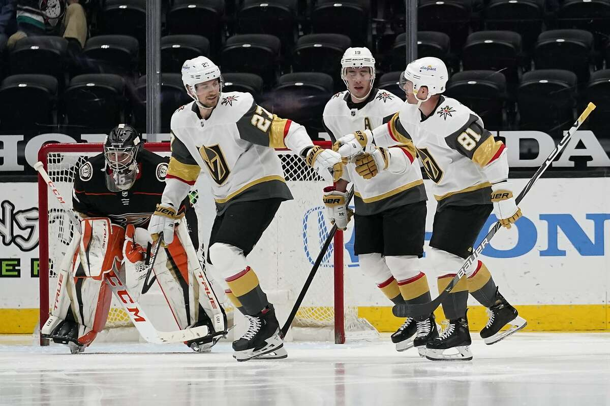 Vegas' Shea Theodore (27) congratulates Reilly Smith and Jonathan Marchessault (81) after the two assisted on a goal.