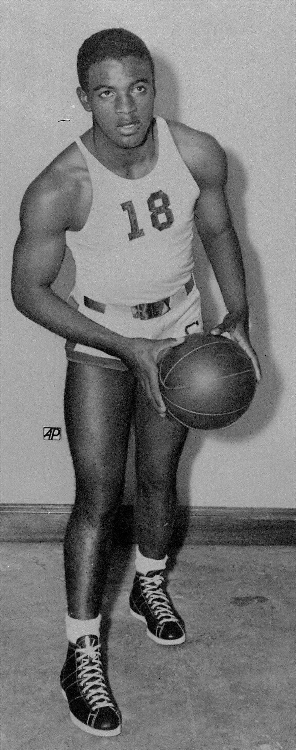 Jackie Robinson, football and basketball great with UCLA, poses in his basketball uniform in this undated photo. Robinson is a native of Pasadena, California. (AP Photo)