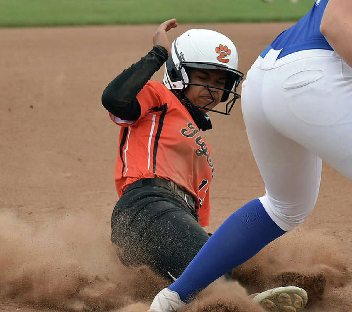 Edwardsville's Zoie Boyd slides safely into third base for a steal in the second inning against Freeburg on Friday.