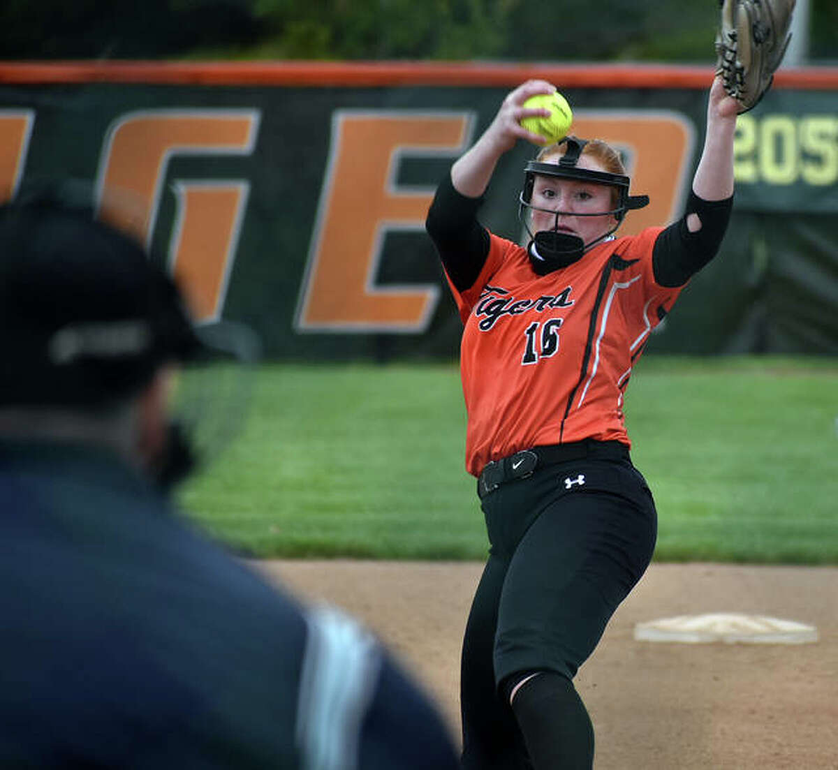 Edwardsville's Brooke Tolle fires in a first-inning pitch to a Freeburg hitter.