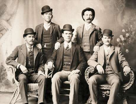 """This photo of the Wild Bunch taken in Fort Worth in 1900 shows Ben Kilpatrick, """"The Tall Texan"""" seated in the center between Harry Longabaugh, known as the Sundance Kid (left), and Butch Cassidy (right). Kilpatrick was killed in March 2012 during the last full-sized train robbery in Texas by the freight manager on the train, who was from San Antonio."""