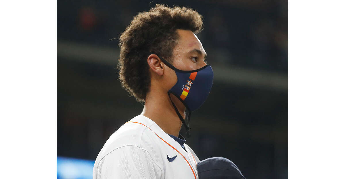 Houston Astros Taylor Jones during the National Anthem before the first inning of an MLB baseball game at Minute Maid Park, in Houston, Wednesday, April 14, 2021.
