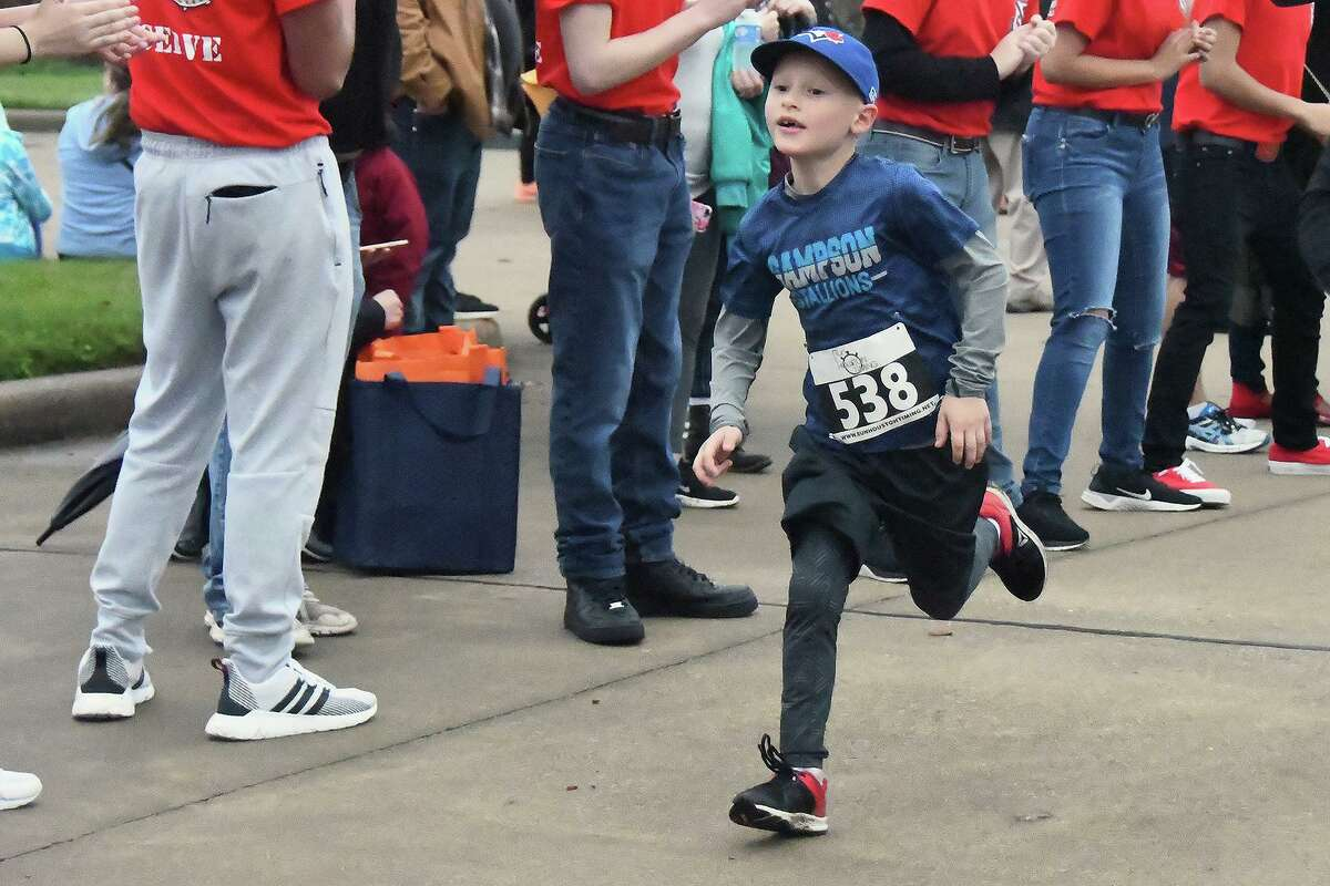 """In this photo from before the pandemic, a boy participates in a previous year's Cy-Fair ISD Superintendent's Fun Run. This year, the Cy-Fair ISD Superintendent's Fun Run will be virtual, encouraging participants to """"run together from wherever."""""""