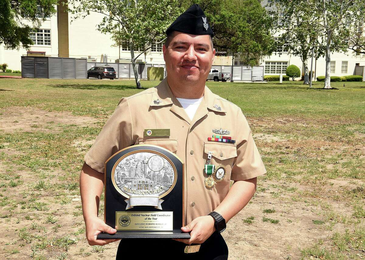Electrician's Mate (Nuclear) 1st Class Roberto Rangel Jr., of Houston, the Nuclear Field Program coordinator assigned to Navy Talent Acquisition Group (NTAG) San Antonio, was awarded the Navy and Marine Corps Commendation Medal and trophy by NTAG Commanding Officer Cmdr. Michael Files at NTAG headquarters. Rangel earned the award for being the NTAG's Enlisted Nuclear Field Coordinator of the Year for Fiscal Year 2020.