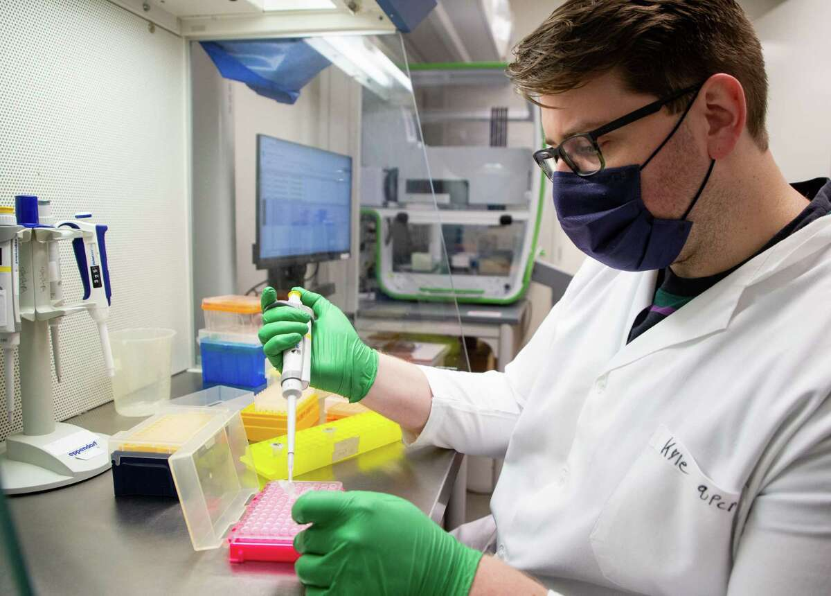 Research technician Kyle Palmer works to add reagents to the RNA that has been extracted from the waste water, the reagent helps qualify the variant and amount of COVID-19, inside the Stadler lab at Rice University's Brown School of Engineering on Friday, April 9, 2021, in Houston. Rice University, Baylor College of Medicine and Houston Health Department have created a 200-location system to find sars-COV-2 in the city's wastewater. By analyzing sewage, the scientists and city are able to see which neighborhoods are still affected by the virus, where the UK variant is most prevalent and if Houston is developing its own variant.