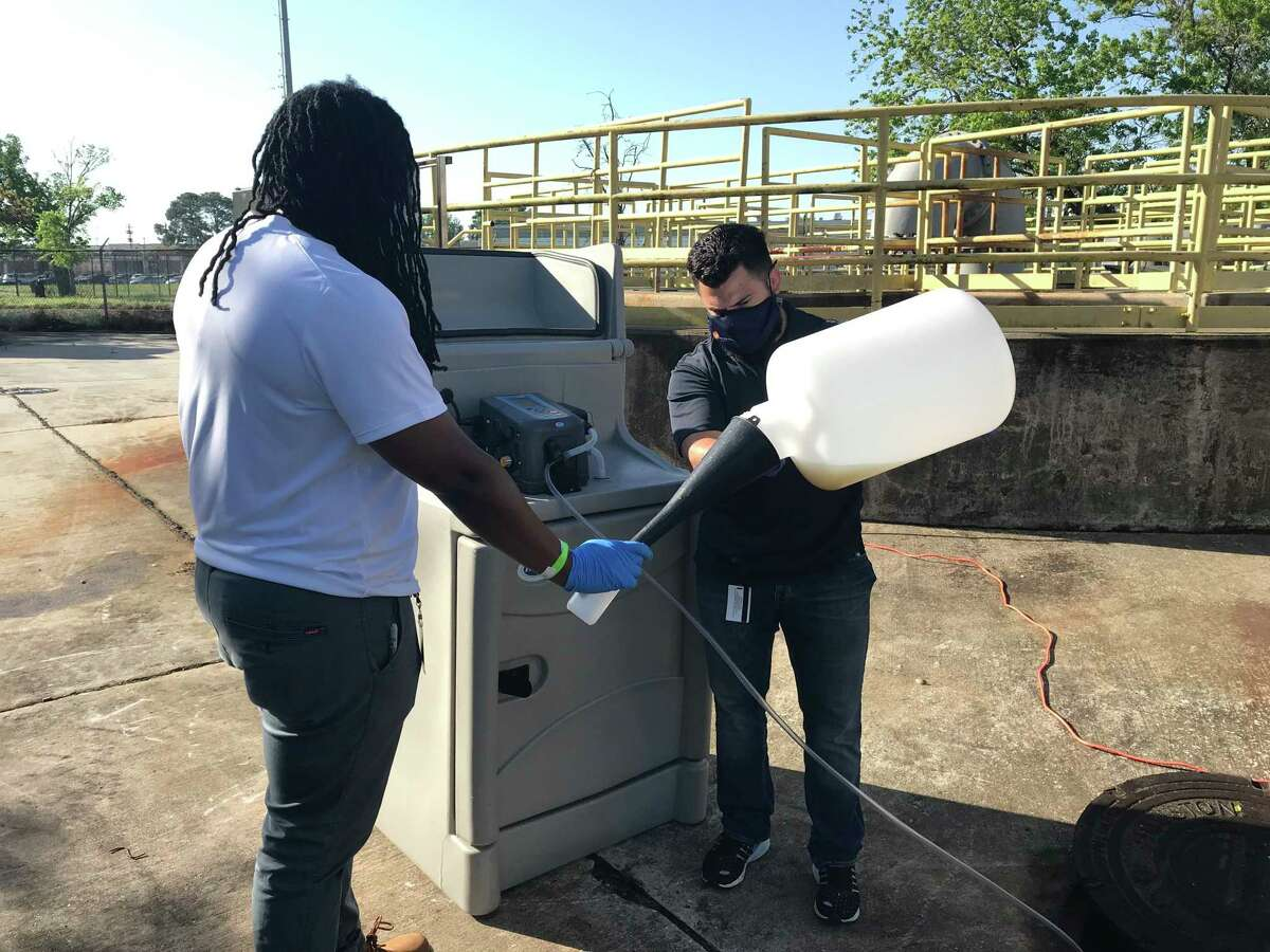 Houston Public Works employees handle wastewater samples at various lift stations and manholes in the city in April to test for COVID-19. The city on Wednesday launched a dashboard online that allows residents to see the virus levels near them.