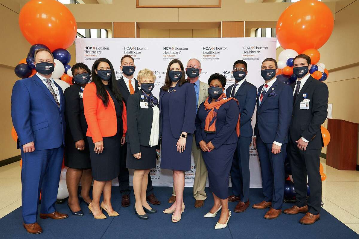 Among those celebrating the finished renovations to the beautification project included from left, Jeffrey Mills, Chief Nursing Officer; Nakia McMullen, VP, Quality; Tricia McGusty, Chief Operating Officer; Scott Davis, Chief Executive Officer; Mary Claire Dangel-Palmer, ACNO; Crystal Hollier, VP, Business Development; Thomas Holt, Chief Financial Officer; Melanie Webb, VP, Human Resources; Tremaine Gibson, VP, Operations; Ahmad Maarouf, MD, Chief Medical Officer; and Demetri Magoulas, ACFO.