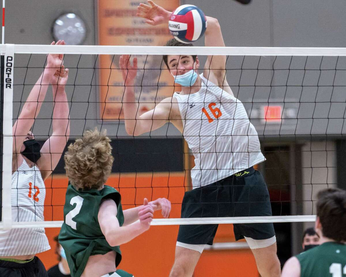 Bethlehem three-sport senior Marko Gibbons (16) goes up to block a spike by Shenendehowa Freshman Bennett Wilson during a Suburban Council match at Bethlehem High in Delmar, NY, on Wednesday, April 14, 2021 (Jim Franco/Special to the Times Union)