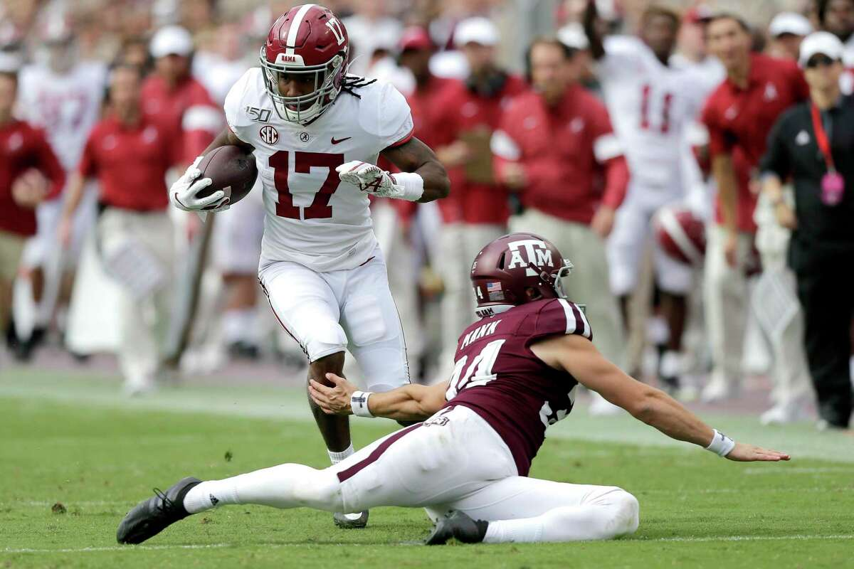 Alabama wide receiver Jaylen Waddle (17) jukes Texas A&M punter Braden Mann (34) during a punt return during the first half of an NCAA college football game, Saturday, Oct. 12, 2019, in College Station, Texas. (AP Photo/Sam Craft)