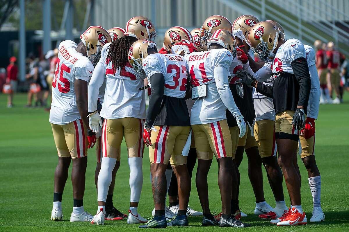 The San Francisco 49ers defense huddles before drills at the training camp at Levi's Stadium on Tuesday, Aug. 25, 2020 in Santa Clara.