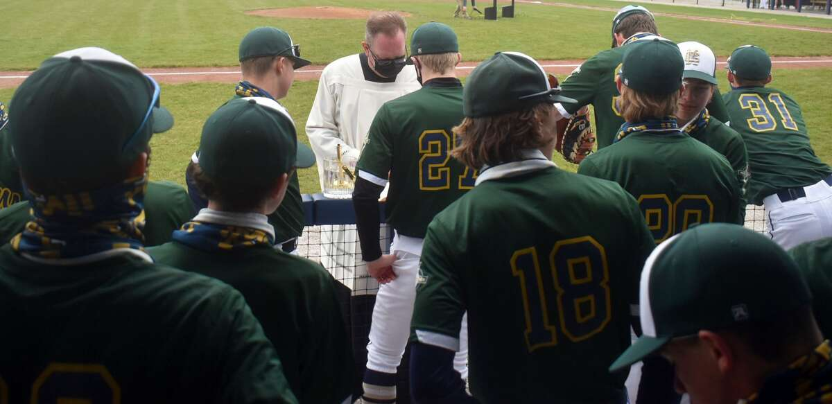 FMCHS President and Very Rev. Jeff Goeckner talks to the team before the field dedication on Saturday.
