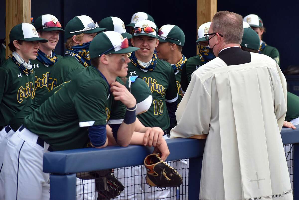 FMCHS President and Very Rev. Jeff Goeckner talks to the team before the start of the field dedication on Saturday.