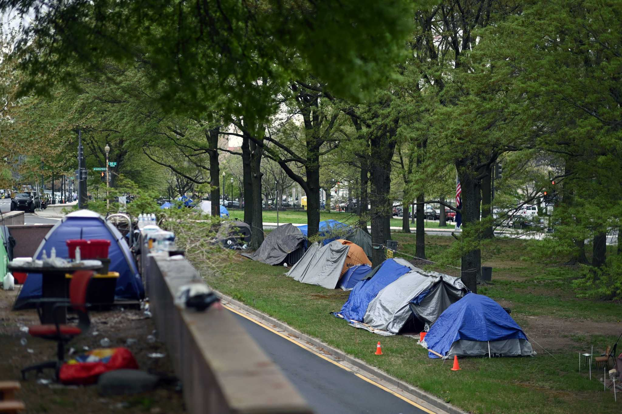 Two blocks from Federal Reserve, a growing encampment of homeless grips economy's most powerful person