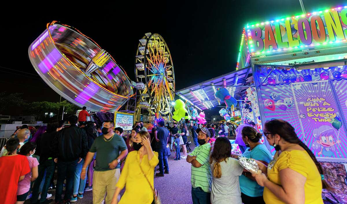 Laredoans head to the Sames Auto Arena parking lot on Friday, April 16, 2021 for the Spring Fling Carnival.