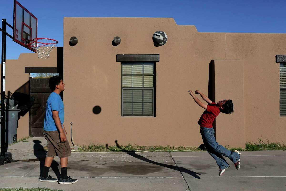 Children shoot hoops outside a home at the Ysleta del Sur Pueblo in El Paso. The experience of living between two worlds has been - and will forever be - essential and important to the United States.