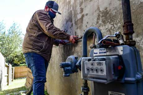 Plumber Alex Ortega of Beyer Boys works on rupture pipes on a home in the Stone Oak area of the city on Friday, Feb. 19, 2021. The recent subfreezing temperatures across Texas caused many pipes to burst.