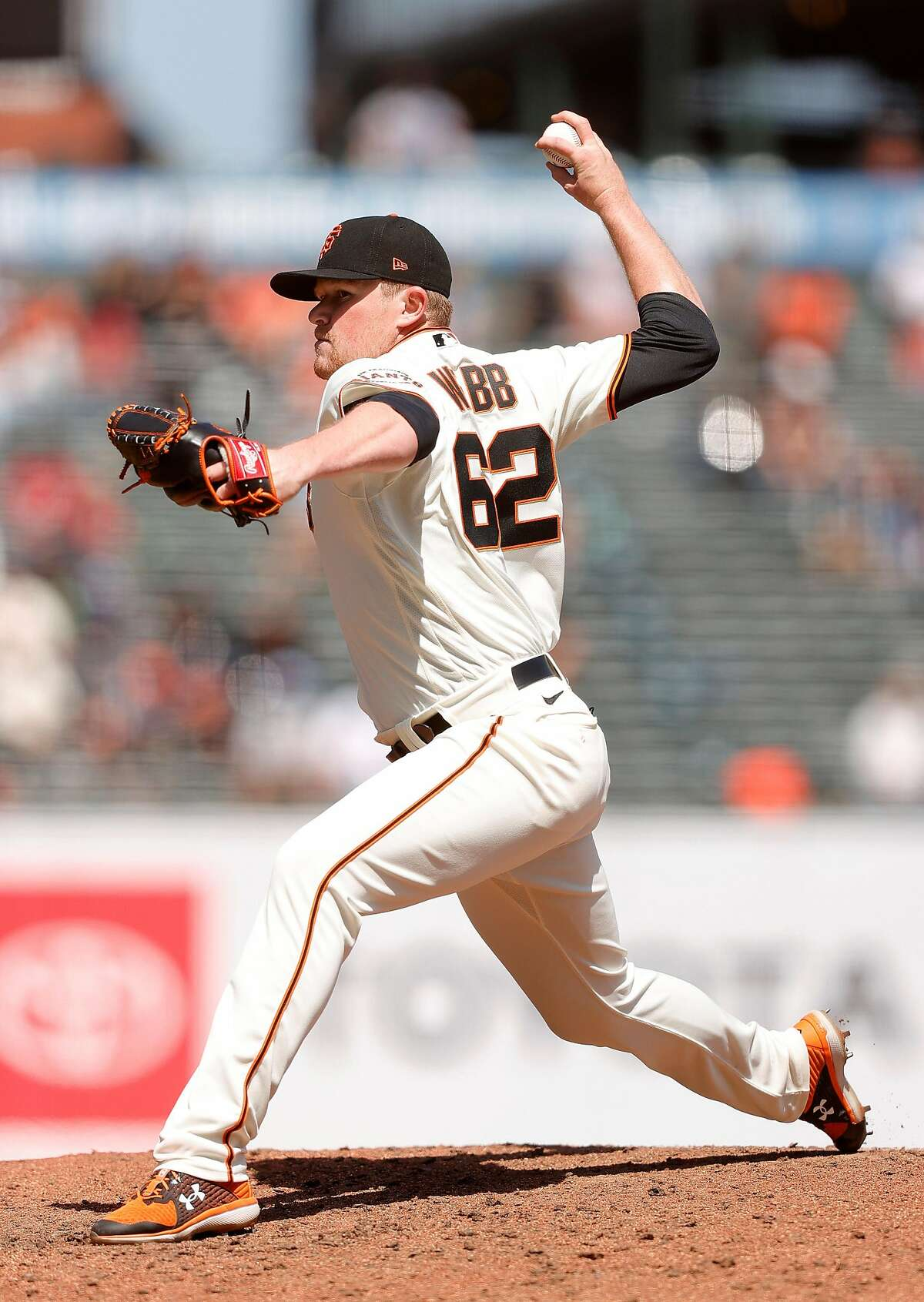 SAN FRANCISCO, CALIFORNIA - APRIL 14: Logan Webb #62 of the San Francisco Giants pitches against the Cincinnati Reds in the seventh inning at Oracle Park on April 14, 2021 in San Francisco, California. (Photo by Ezra Shaw/Getty Images)
