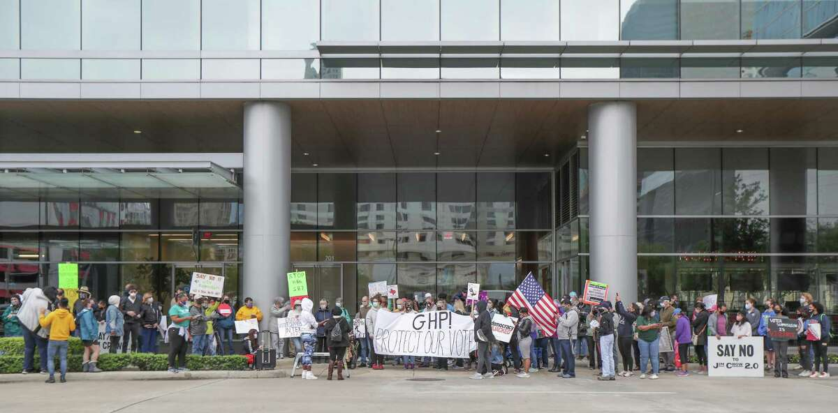 Voters and activist organizations at the Greater Houston Partnership building, demanding the business group oppose the voter bills being considered by the Texas legislature, Saturday, April 17, 2021, in Houston.