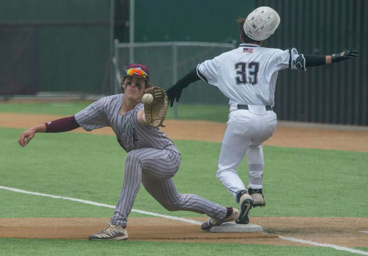 Lee's Chase Shores reaches for the ball but Odessa Permian's Sebastian Bravo safely reaches first 04/17/2021 at McCanlies Field field in Odessa. Tim Fischer/Reporter-Telegram