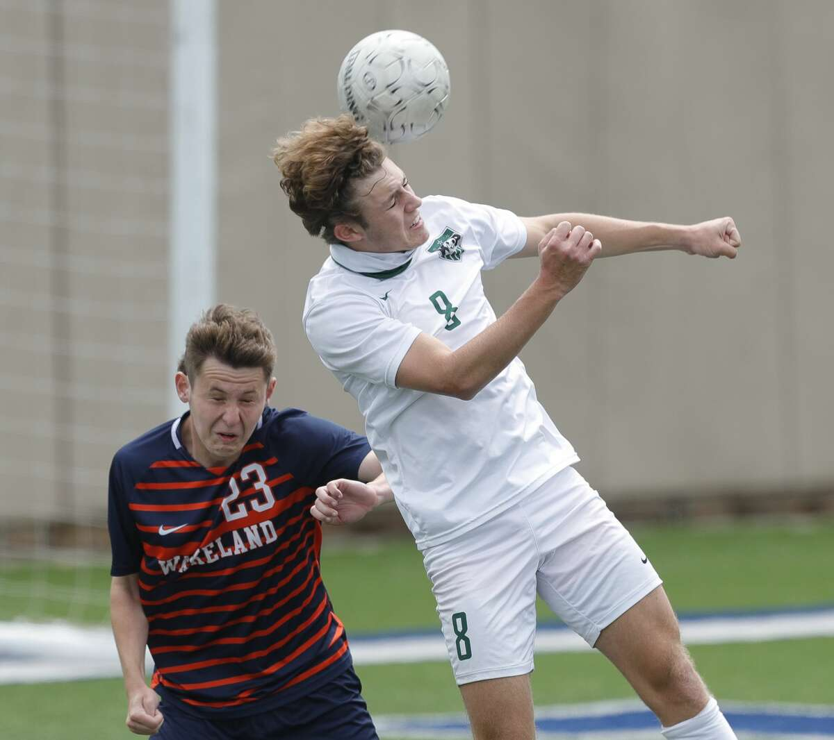 Kingwood Park forward Nathan Jimerson (8) heads the ball against Frisco Wakeland defender Jacob Rulon (23) in the first period of the UIL Class 5A boys soccer championship, Saturday, April 17, 2021, in Georgetown.
