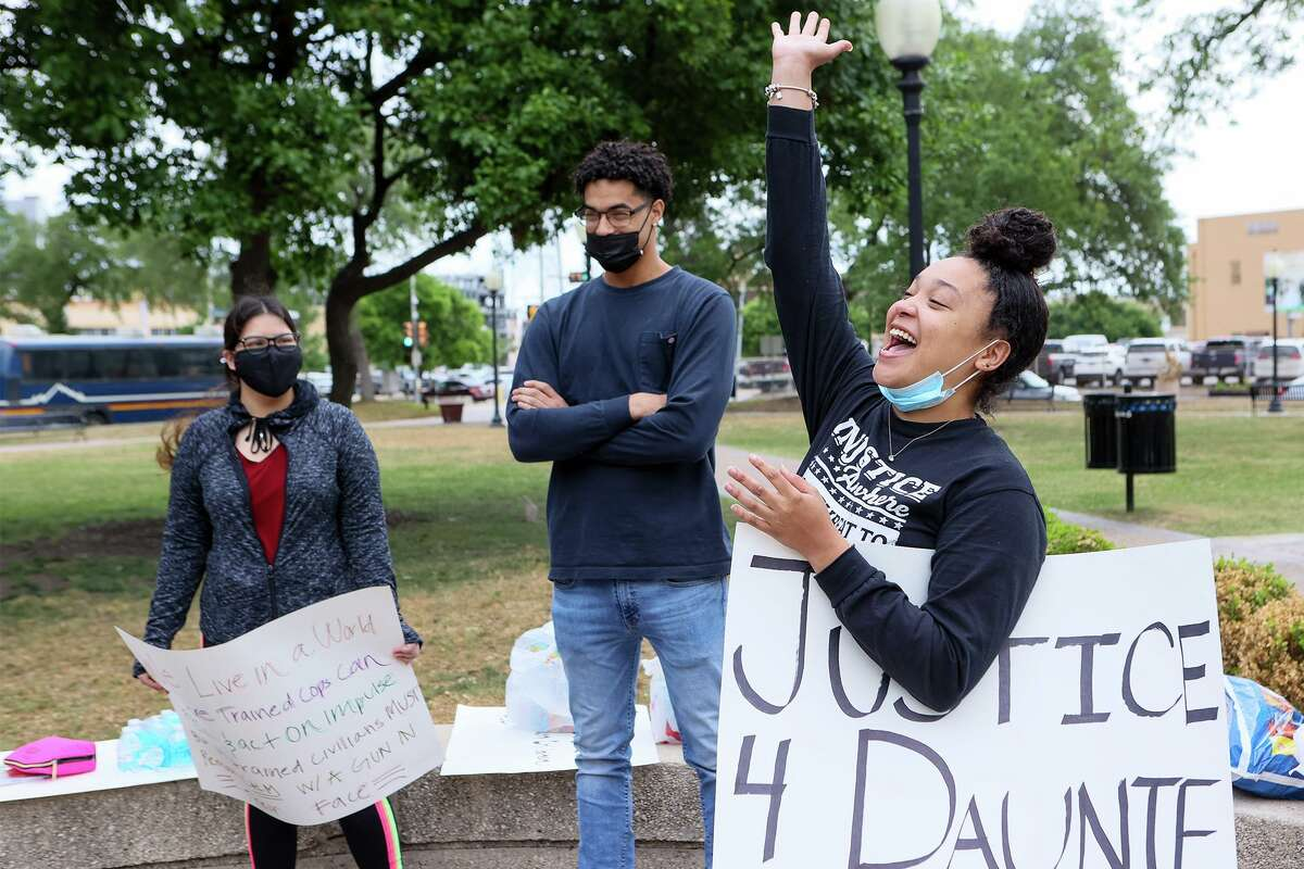 Digna Candelario, 21, rejoices during a peaceful gathering at Travis Park on Saturday, April 17, 2021, to remember Daunte Wright, a Black man who was killed by a police officer in Minnesota last week, and Marvin Scott, who died in police custody in the Collin County Jail in Texas. Candelario, a political science major at Northwest Vista College, organized the event.